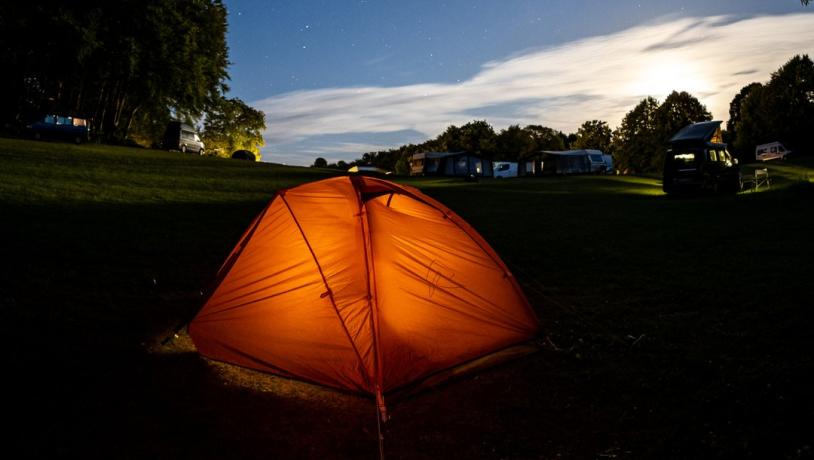 A tent pitched at Camp Møns Klint on a starry night.